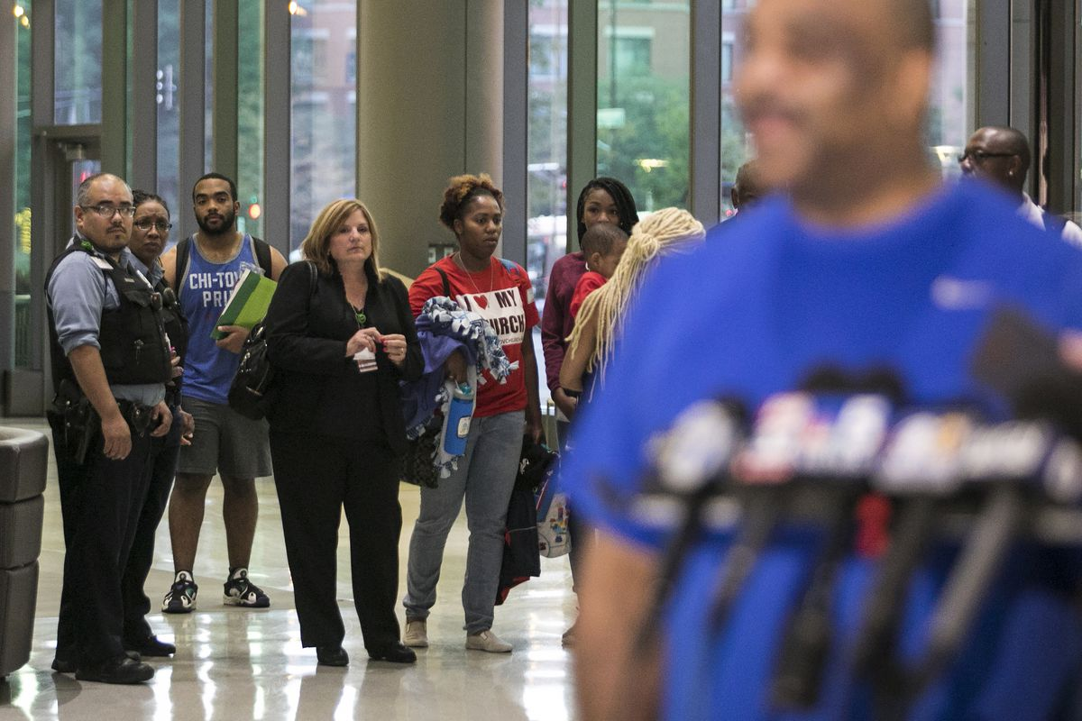 Chicago Police Supt. Eddie Johnson's family watches as he addresses the media before kidney transplant surgery at Rush University Medical Center on Wednesday morning. Johnson's 25-year-old son, Daniel, Johnson (blue tank top) is donating a kidney to his f