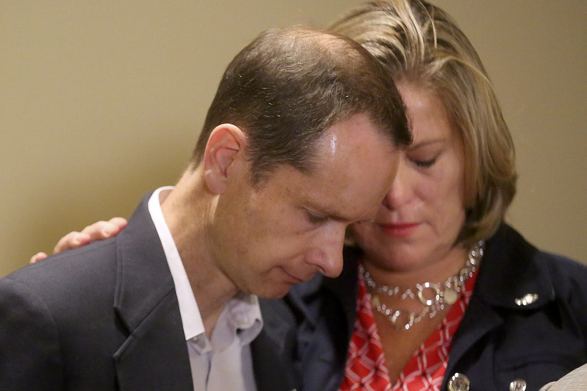 Matt McCluskey and Jill McCluskey embrace during a press conference at the offices of Siegfried and Jensen in Murray on Thursday, June 27, 2019. The McCluskeys are suing the University of Utah for $56 million, alleging the school failed to protect their daughter Lauren despite her calling campus police more than 20 times for help before her murder.