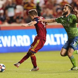 Real Salt Lake forward Corey Baird (17) shoots and scores a goal with Seattle Sounders defender Jonathan Campbell (3) trying to disrupt as RSL and Seattle play at Rio Tinto Stadium in Sandy, Utah, on Wednesday, Aug. 14, 2019. RSL won 3-0.