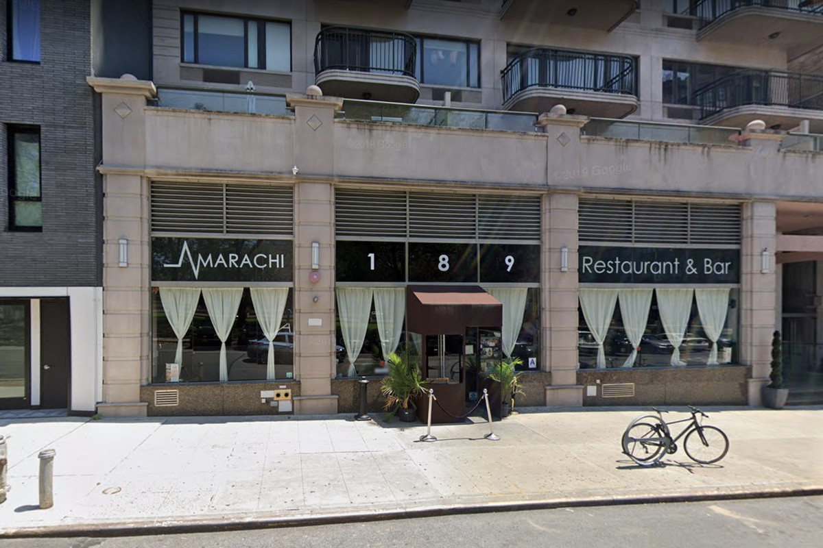 Amarachi's storefront, with white curtains in the windows