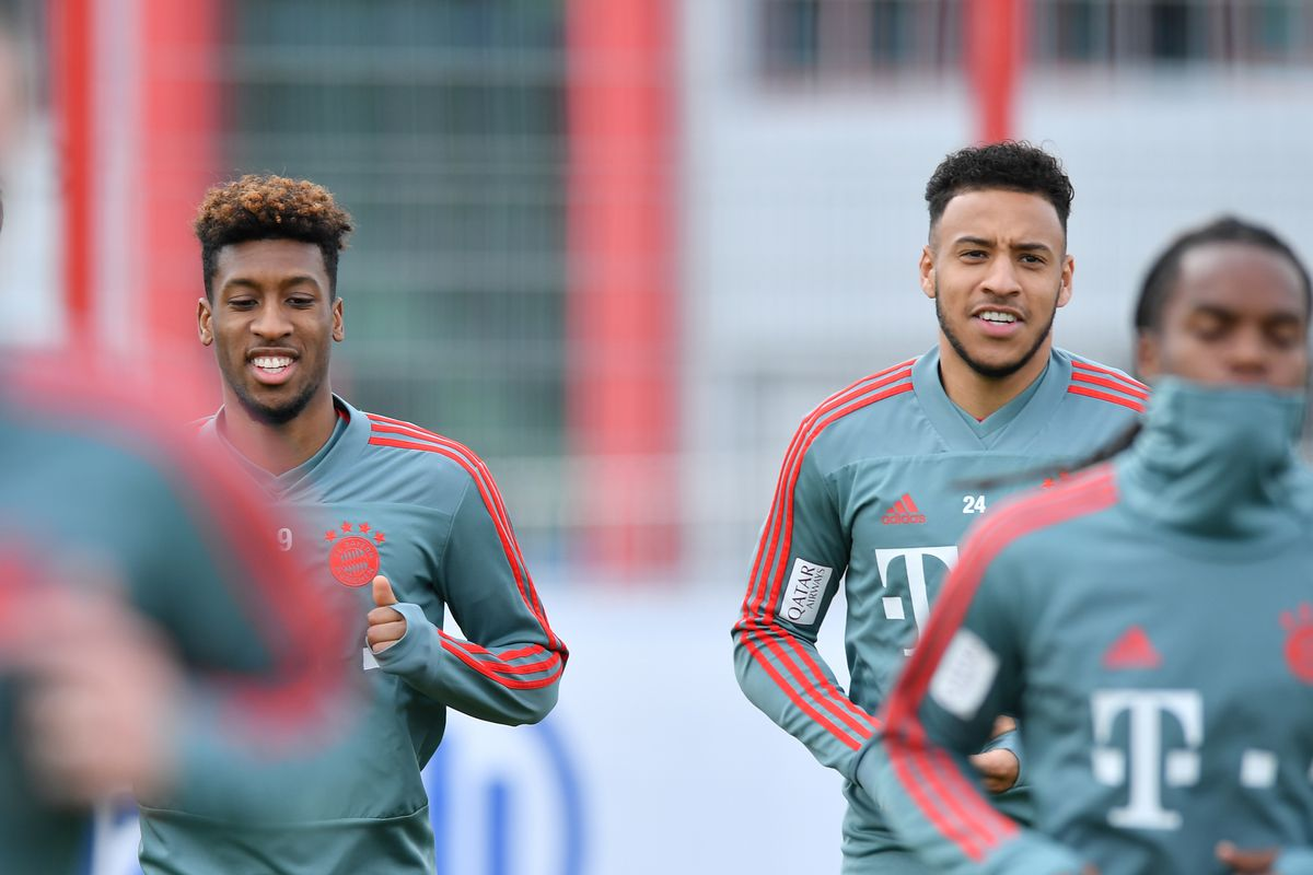 Bayern Muenchen Training Session MUNICH, GERMANY - MARCH 26: Kingsley Coman (l) and Corentin Tolisso of Bayern Munich run during a training session at Saebener Strasse training ground on March 26, 2019 in Munich, Germany.
