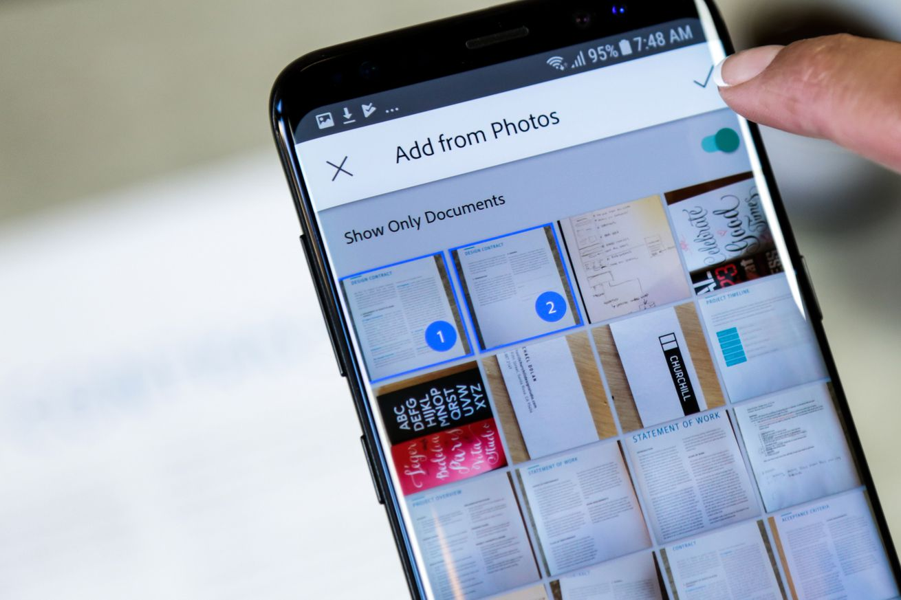 adobe scan now uses ai to surface docs business cards and receipts in your camera roll
