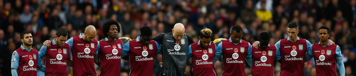 Aston Villa players observe a moment of silence before their match against Manchester City.