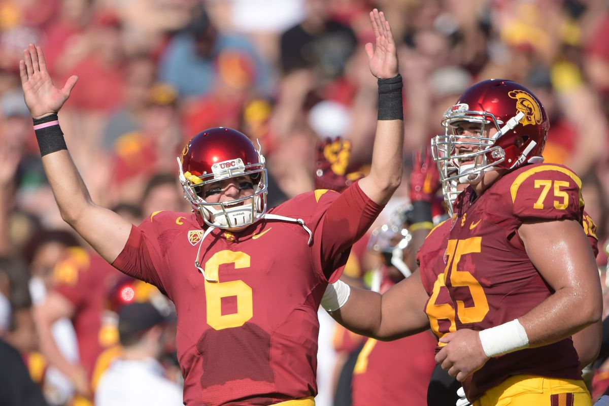 Cody Kessler celebrates one of his record-setting seven touchdowns.