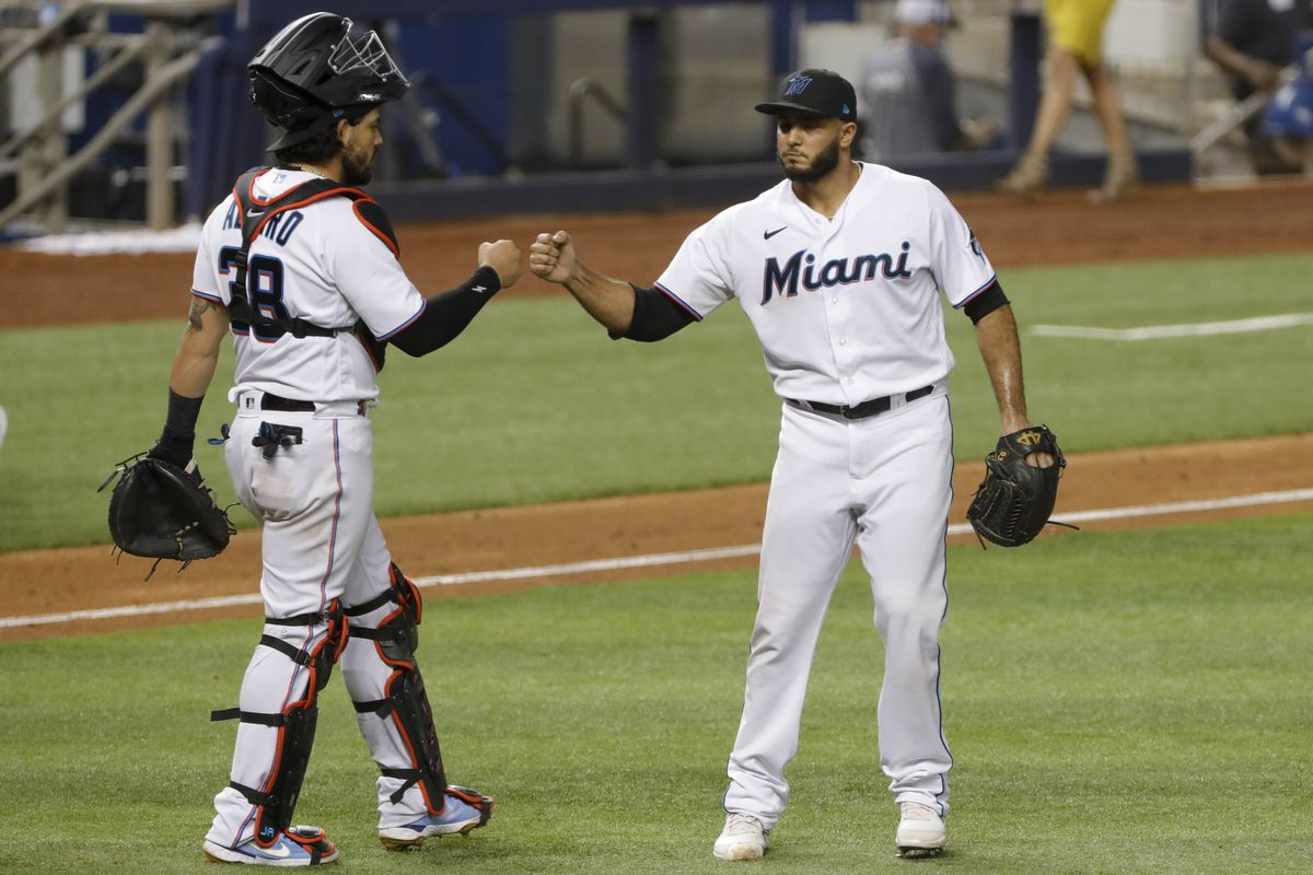 Miami Marlins relief pitcher Yimi Garcia (93) celebrates with catcher Jorge Alfaro (38) after winning the game against the Philadelphia Phillies at loanDepot Park.