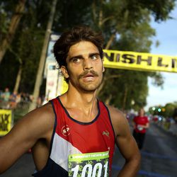Jordan Cross catches his breath at the finish line as the winner of the Deseret News Half Marathon in Salt Lake City on Friday, July 23, 2021.