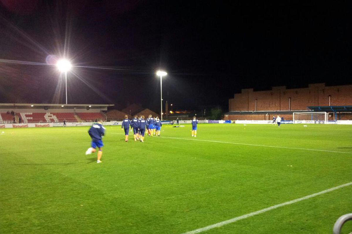 Oldham Athletic warm up prior to facing Bolton Wanderers, with Stu Holden and Josh Vela in tow.