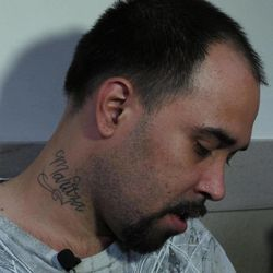 Christian Mercado, a Milwaukee man whose pregnant wife was killed last year by a woman who carved out his wife's fetus in hopes of raising the boy as her own, struggles for words on Thursday, Sept. 20, 2012, minutes after a jury convicted the suspect of two counts of intentional homicide. A tattoo on his neck shows the first name of his wife, Maritza Ramirez-Cruz.