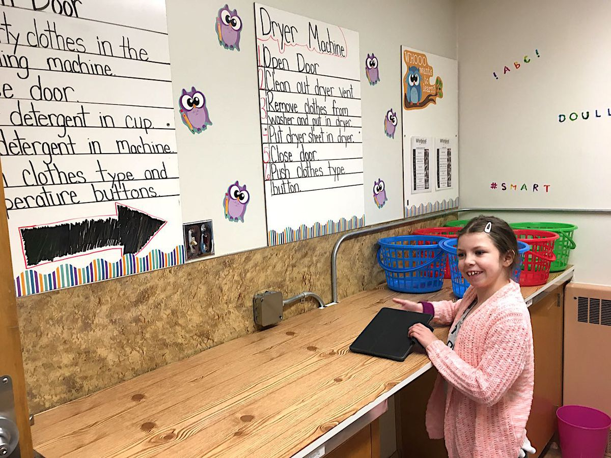Morgan Pohl stands in the new laundry room at Doull Elementary School.