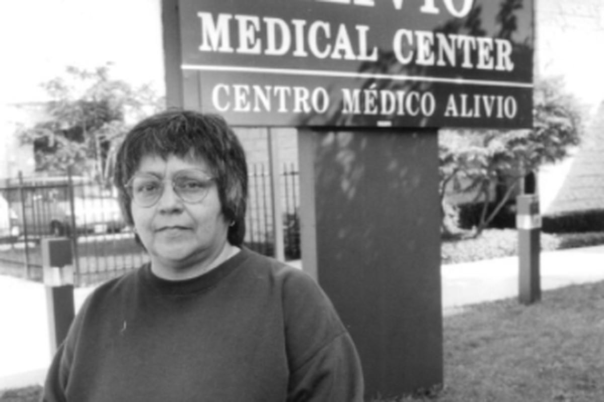 Carmen Velásquez stands outside the Alivio Medical Center