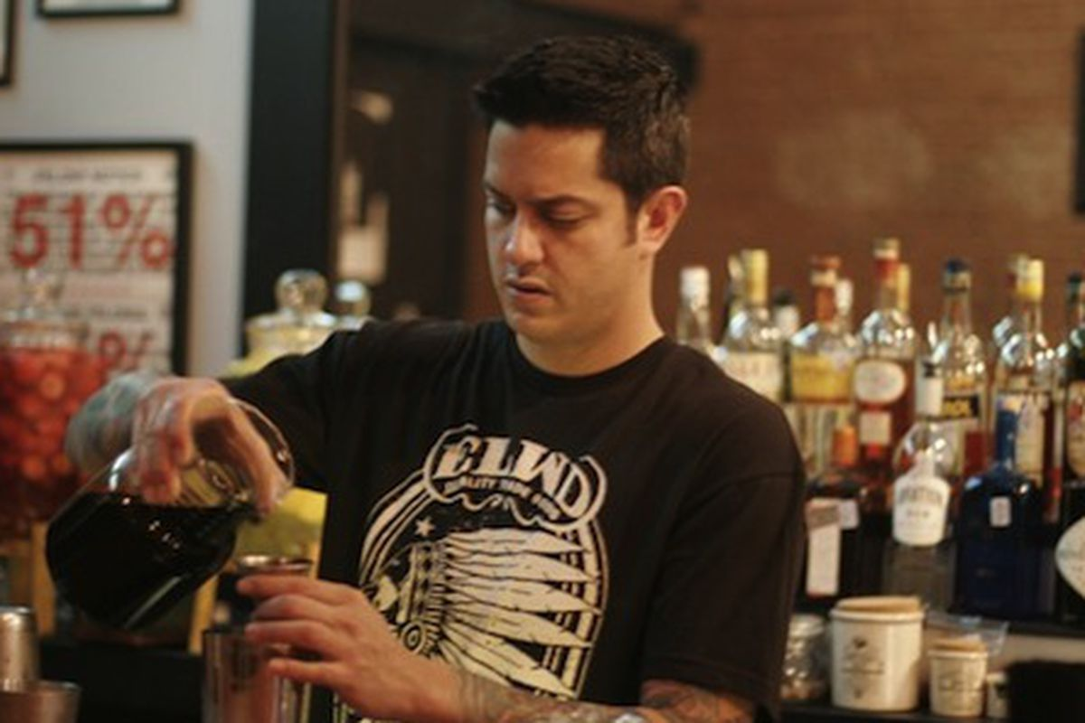 Gabe Sanchez prepares coffee-infused bourbon at Black Swan Saloon