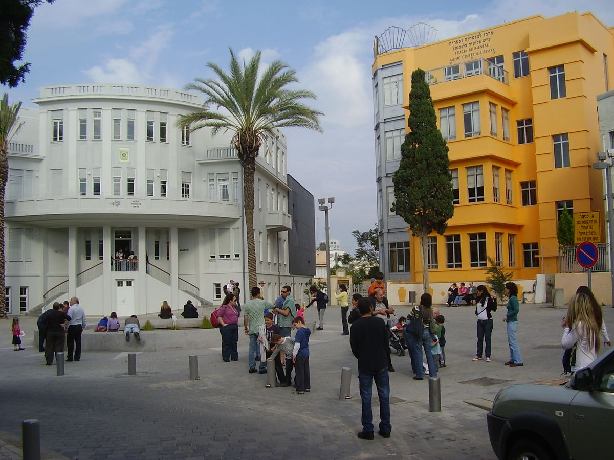 Bialik Square in Tel Aviv. The square is full of people and is surrounded by assorted city buildings.