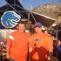 Boise State fans Micah Cranny and Darran Coburn pose in front of their impressive Broncos-themed tailgate at BYU.