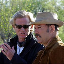 """James Redford gives direction to Ruben Blades on the set of """"Spin"""" in Arizona."""