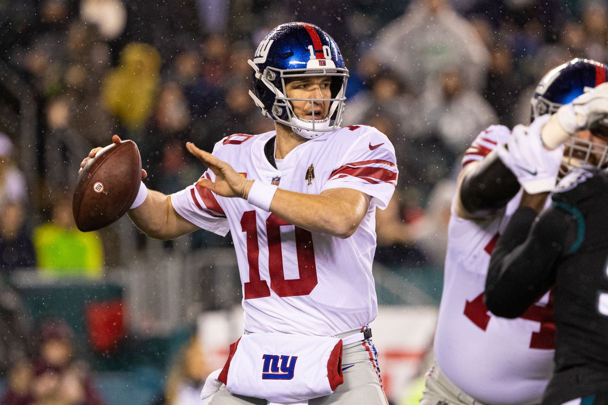 New York Giants quarterback Eli Manning passes the ball against the Philadelphia Eagles during the first quarter at Lincoln Financial Field.