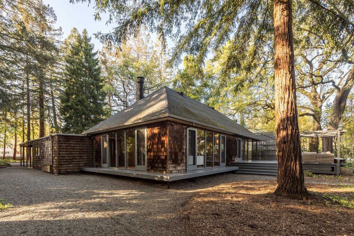 Wood-shingled facade of Atherton home, single story.