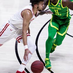 Utah Utes forward Timmy Allen (1) drives against Oregon Ducks guard Amauri Hardy (11) during the game at the Huntsman Center in Salt Lake City on Saturday, Jan. 9, 2021.