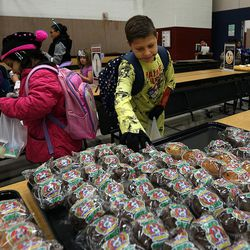 Edison chooses his food during the Breakfast in the Classroom program at Backman Elementary School in Salt Lake City on Friday, Oct. 28, 2016. At left is student Nornishar.