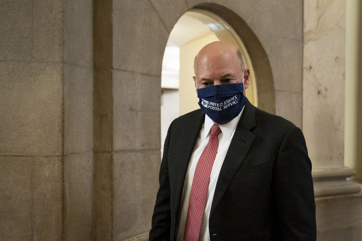 "Postmaster General Louis DeJoy wearing a face mask with ""United States Postal Service"" written on it."