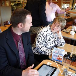 Bob Jackman, front left, and Connie Marston, delegates, discuss candidates as Carl Wimmer, back center, a candidate for the 4th Congressional District, talks with Lynn Hill, a delegate, at IHOP in West Jordan, Wednesday, April 4, 2012.