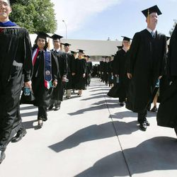 BYU graduates march to the Marriott Center for BYU's summer commencement exercises. Aug. 17, 2006.