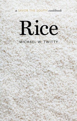 """The cookbook cover for """"Rice"""" featuring a closeup of uncooked rice"""