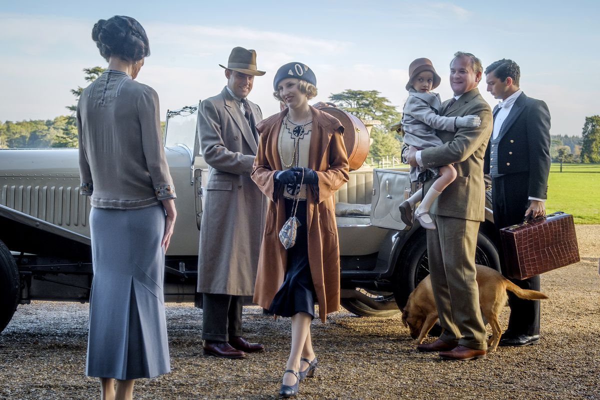 """The Crawley family arriving at the house in a roadster in the movie """"Downton Abbey."""""""