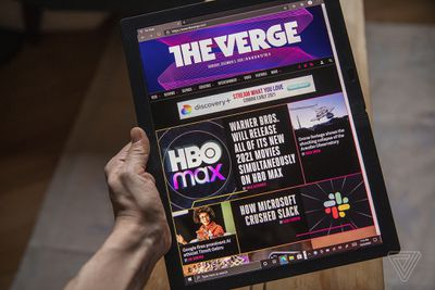 The Lenovo ThinkPad X1 Fold in tablet mode, displaying The Verge's homepage.