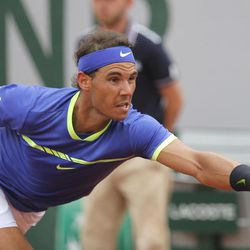 Spain's Rafael Nadal stretches to return the ball to Switzerland's Stan Wawrinka during their final match of the French Open tennis tournament at the Roland Garros stadium, Sunday, June 11, 2017 in Paris.