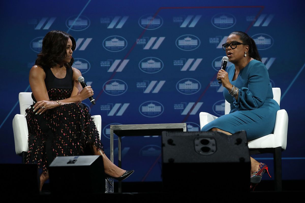 Michelle Obama and Oprah Winfrey on stage at a Washington, DC conference in 2016. According to a new poll, both women would beat Trump for the presidency in 2020 — but neither has plans to run.