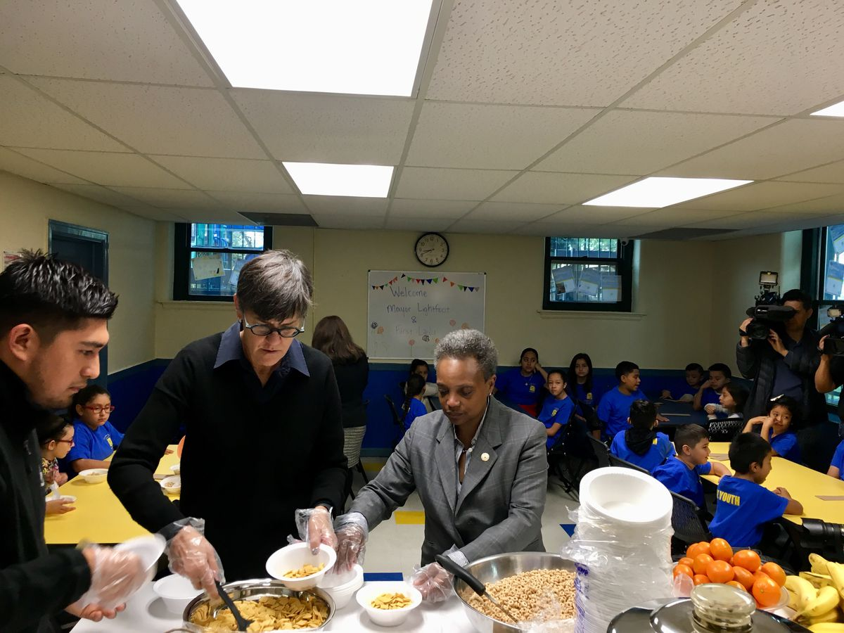 Chicago Mayor Lori Lightfoot and her wife, Amy Eshleman, served breakfast to children on the second day of Chicago's teachers strike, Oct. 18, 2019.