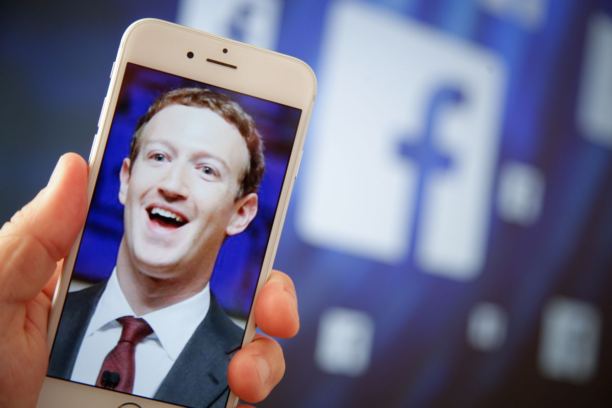 A portrait of Facebook found Mark Zuckerberg is seen on an iPhone in this photo illustration on Aug. 28, 2017.