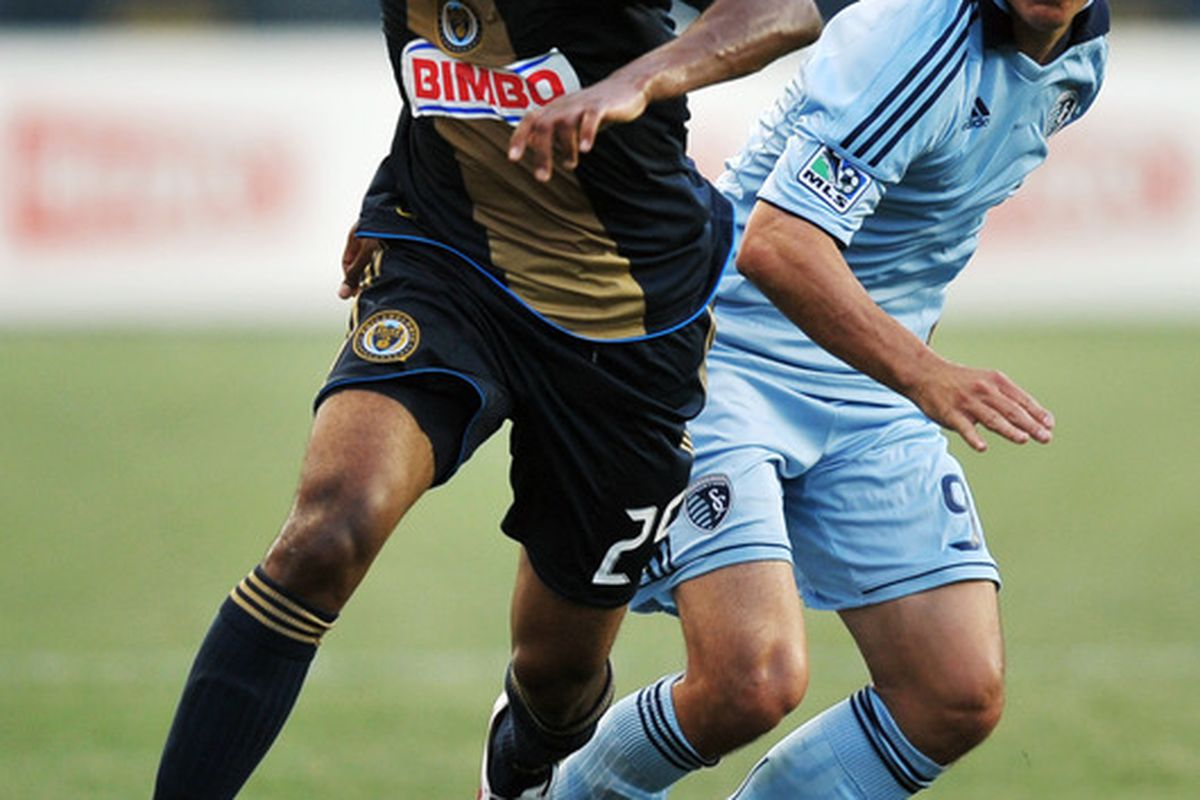 CHESTER, PA - JUNE 22:  Sheanon Williams #25 of the Philadelphia Union breaks away from Omar Bravo #99 of Sporting Kansas City at PPL Park on June 22, 2011 in Chester, Pennsylvania. The game ended 0-0.  (Photo by Drew Hallowell/Getty Images)