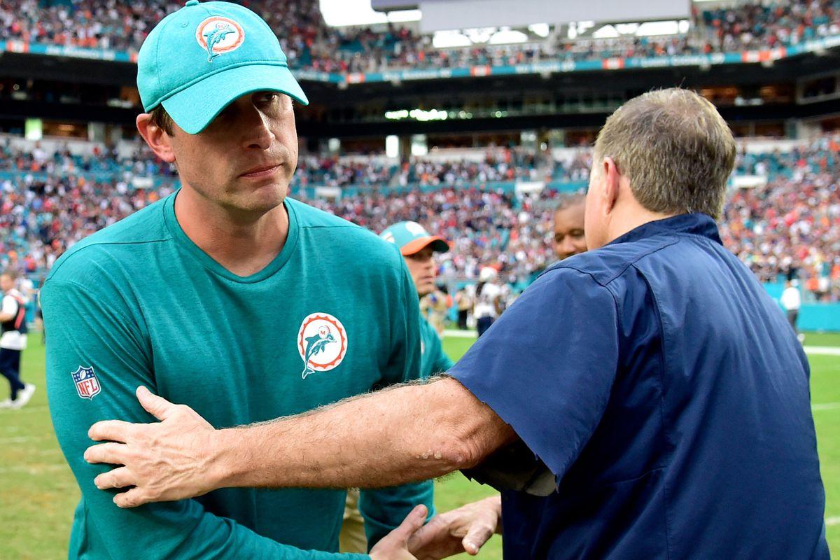 New England Patriots head coach Bill Belichick greets Miami Dolphins head coach Adam Gase after the Dolphins defeated the New England Patriots at Hard Rock Stadium.