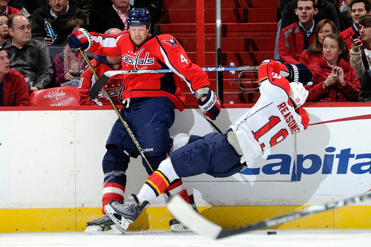 WASHINGTON DC - DECEMBER 09:  John Erskine #4 of the Washington Capitals checks Marty Reasoner #19 of the Florida Panthers at the Verizon Center on December 9 2010 in Washington DC.  (Photo by Greg Fiume/Getty Images)
