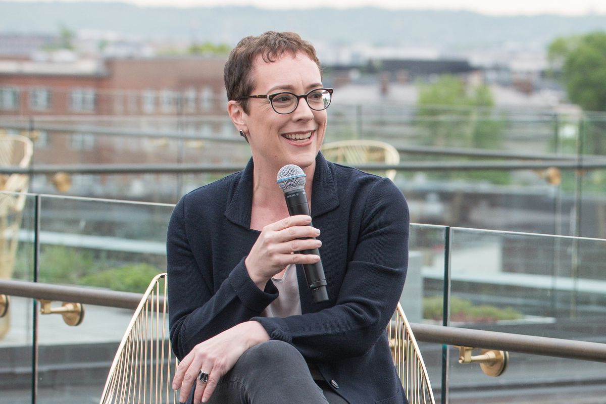 Julia Angwin, former editor-in-chief of The Markup, sitting in a chair and holding a microphone up to her mouth.