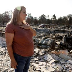 Misty Pantle takes everything in on her first visit to the burned remnants of the home she shared with her children and her sister, Tammy Johnson, in Talent, Ore., on Saturday, Sept. 19, 2020. Their home was one of more than 2,300 residences destroyed when the Almeda Fire swept through the towns of Talent and Phoenix in southern Oregon.