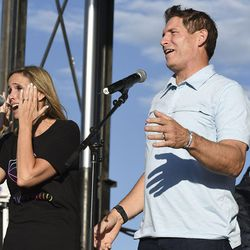 Barb Young wipes her eyes as she and her husband, Steve Young, take the stage during the LoveLoud Festival at Utah Valley University on Saturday, Aug. 26, 2017, in Orem.