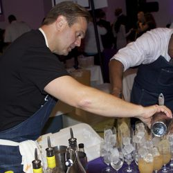 Todd Thrasher behind the bar preparing PX's The Detox cocktail.