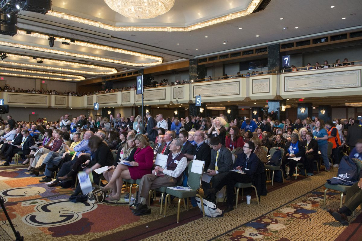NYSUT delegates applaud following the no confidence vote against then-Commissioner John King on April 5, 2014.