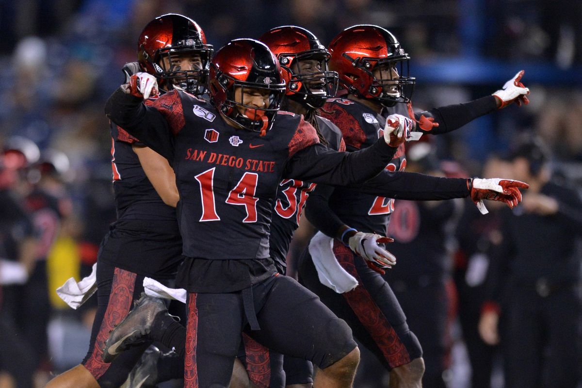 San Diego State Aztecs safety Tariq Thompson (14) reacts after a fourth quarter interception against the Brigham Young Cougars at SDCCU Stadium.