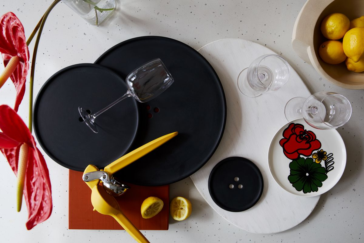 Wine glasses, plates, and kitchen items on a table.