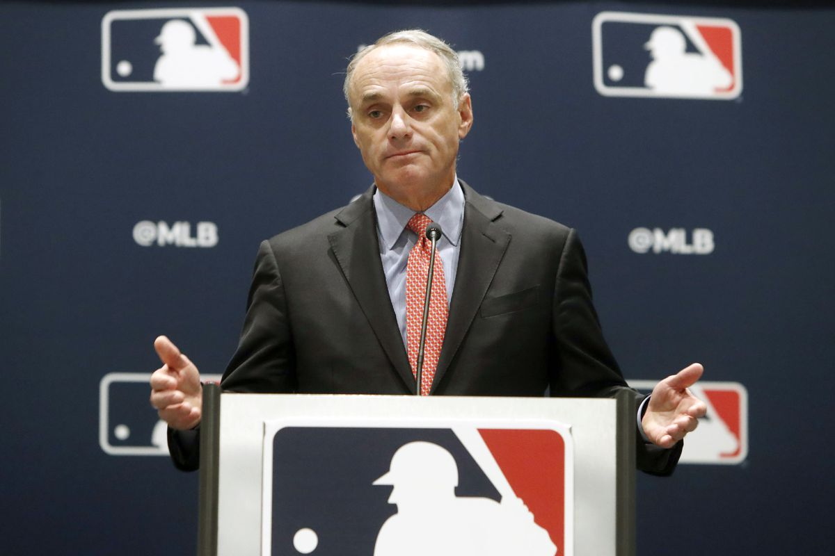 MLB Commissioner Rob Manfred (above) met with players' union head Tony Clark on Wednesday.