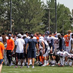 The Denver Broncos come together for one last moment together before concluding the final day of public training camp.
