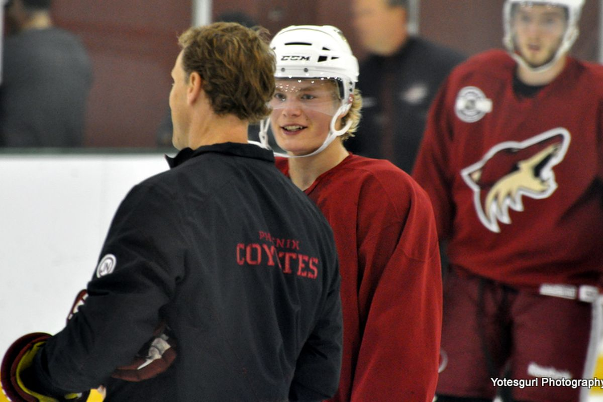 Coyotes Director of Player Development Sean Burke and forward prospect Alexander Ruuttu share a word  during Day 2 of the Phoenix Coyotes 2011 Development Camp. (photo courtesy of Yotesgurl)