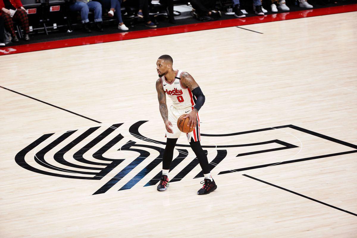 Portland Trail Blazers point guard Damian Lillard controls the ball against the Milwaukee Bucks during the first half at Moda Center.