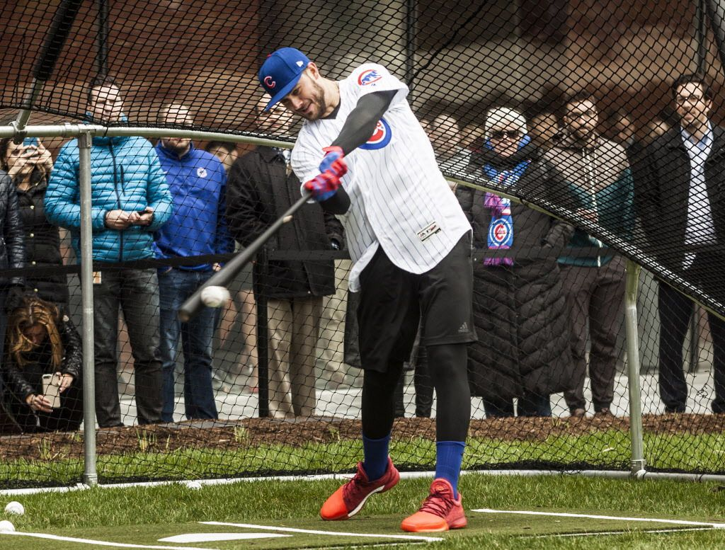 Kris Bryant, Chicago Cubs third baseman, hits baseballs into the Chicago River, aiming for fans standing across the river on April 11. | Maria Cardona/ Sun-Times