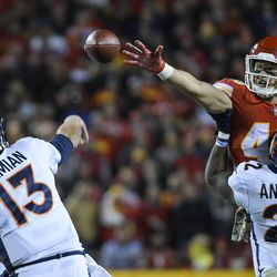 Kansas City Chiefs strong safety Daniel Sorensen (49) nearly blocks this pass by Denver Broncos quarterback Trevor Siemian (13) during the first half of an NFL football game in Kansas City, Mo., Monday, October 30, 2017. (AP Photo/Reed Hoffmann)