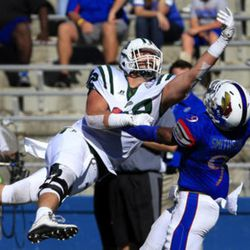 Ohio tight end Troy Mangen (82) tips the ball away from Kansas safety Fish Smithson (9) during the second half of an NCAA college football game in Lawrence, Kan., Saturday, Sept. 10, 2016. (AP Photo/Orlin Wagner)