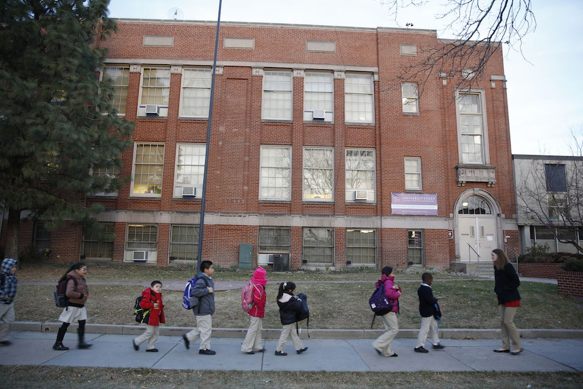Students at University Prep, a DPS charter school, walk in front of the building with their teacher. (Photo by Marc Piscotty/For Chalkbeat)